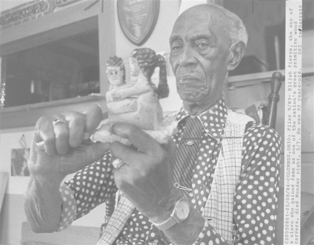 Dick Garrett Photo of Elijah Pierce Carving