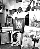 Roman Johnson with his paintings