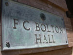 A plaque on FC Bolton Hall bearing its name