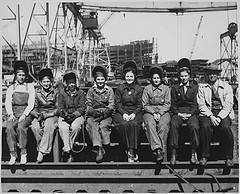 Beebe, Spencer. 'Line Up of Some of Women Welders Including The Women's Welding Champion of Ingalls [Shipbuilding Corp. Pascagoula, Mississippi], 1943', CC license: No known copyright restrictions, Image source: flickr.