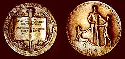 Photograph of the front and back of the Newbery Medal