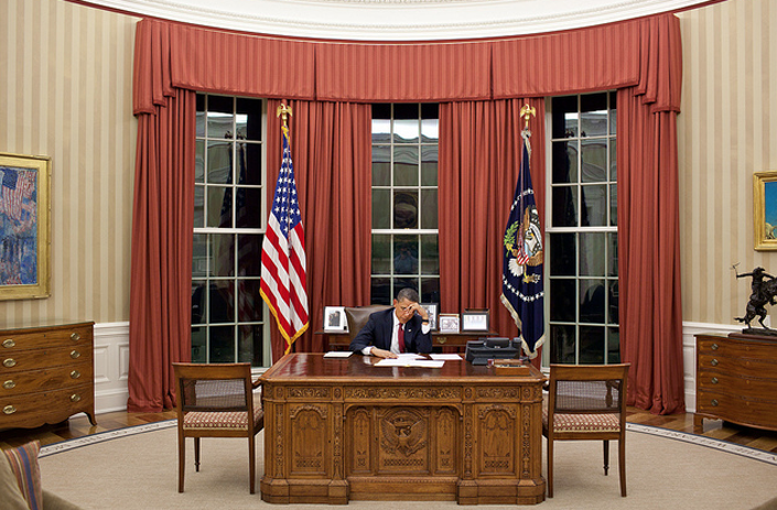 Photograph of President Barack Obama in the Oval Office at the White House in 2011