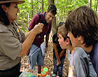 United States Park Ranger working with children in one of the national parks