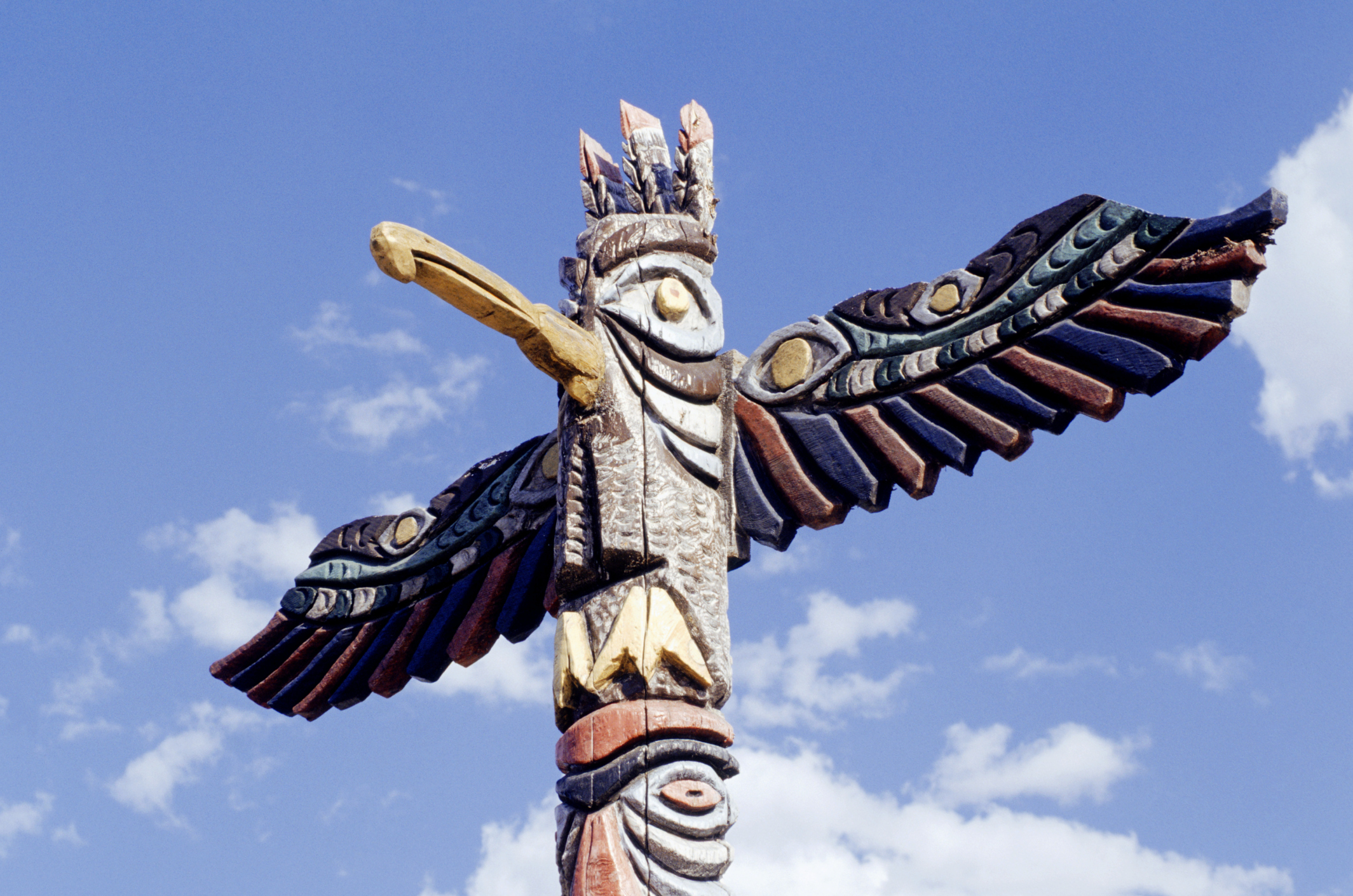 Native American wooden totem in shape of bird, close-up