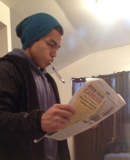 Picture of Nicolas Rincon brushing his teeth while reading El Vaquero