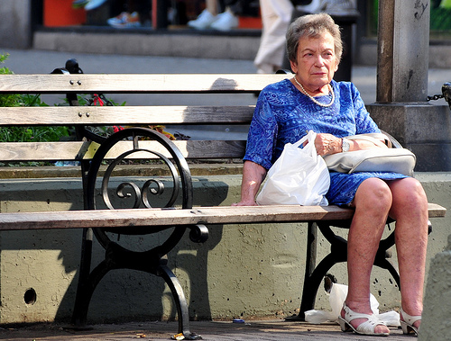 Elderly lady on bench