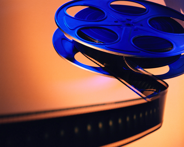 film spooling out of a movie reel