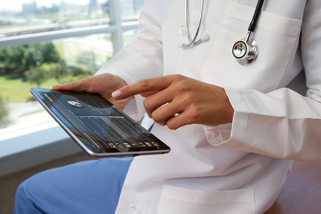 Physician using tablet computer