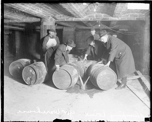 Photograph, Prohibition, small group of men dumping wine from barrels into hole in ground