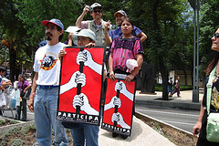 Mexican protesters holding signs