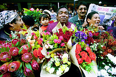 man selling flowers