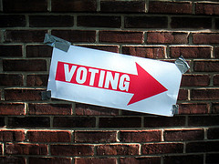 voting sign on a wall
