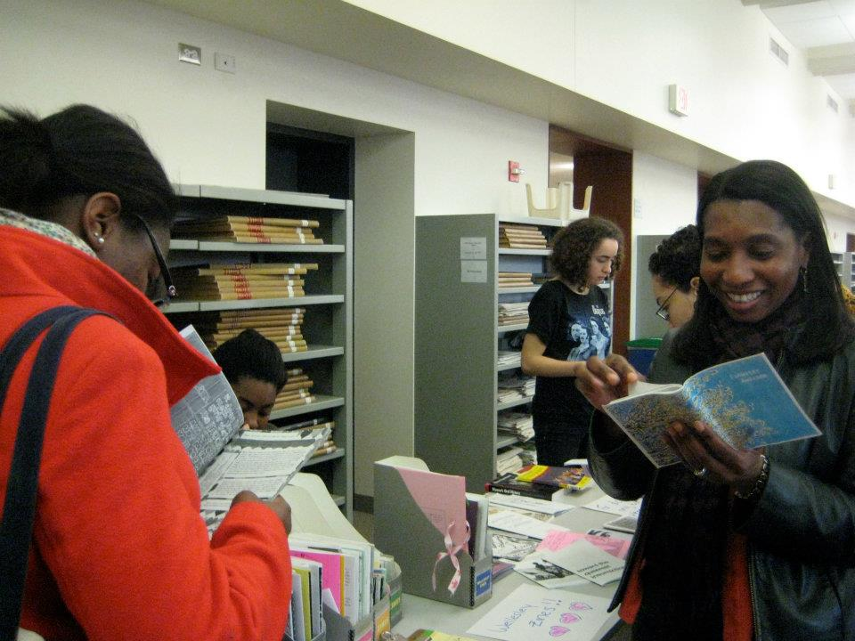 Students looking at zines