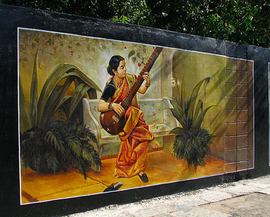 Mural depicting a woman playing a sitar.