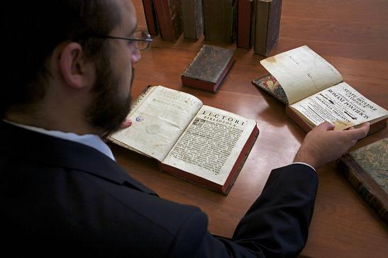 Photo of researcher working with rare books