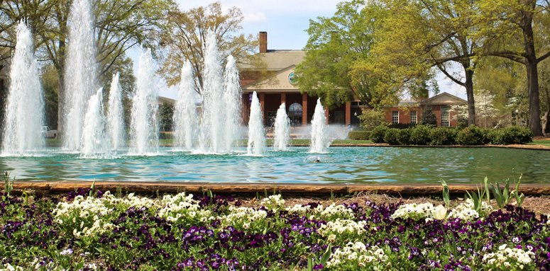 View of Furman's James B. Duke Library across Fountains with Spring Flowers