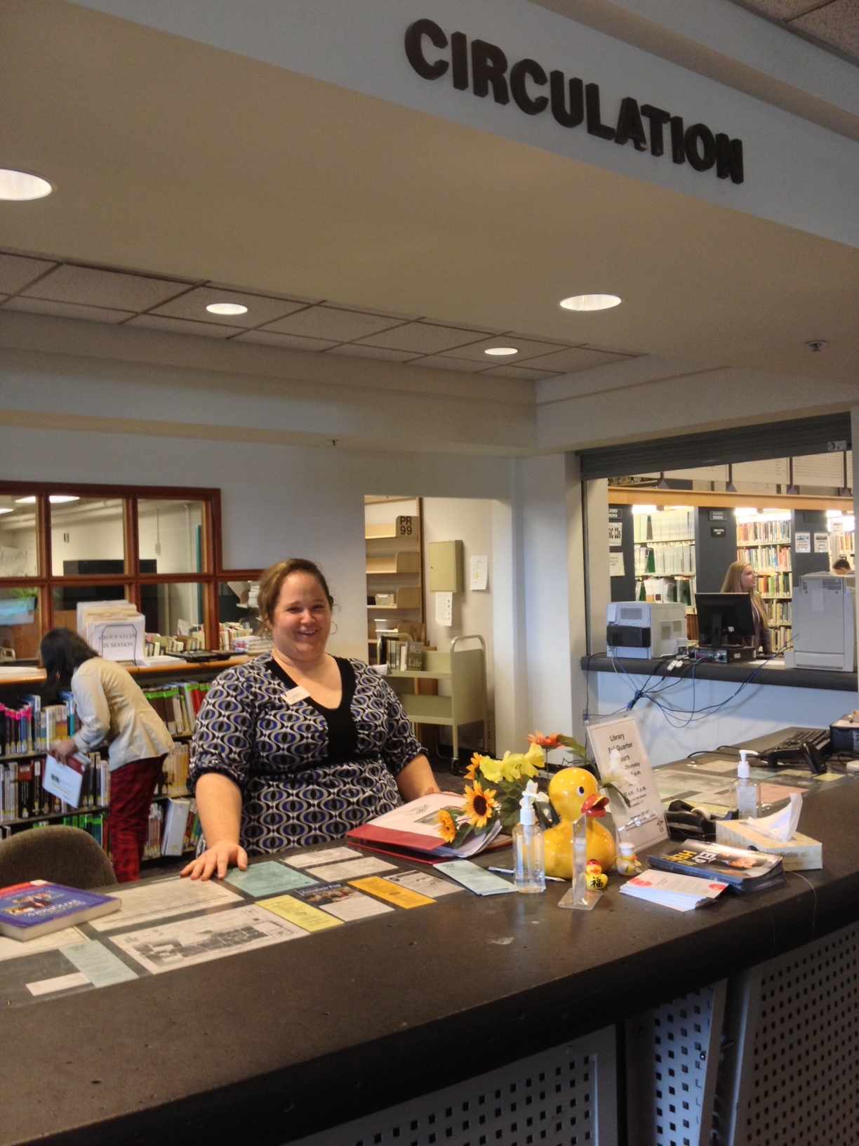 Photograph of Circulation Desk and Jill Merritt, Circulation Supervisor