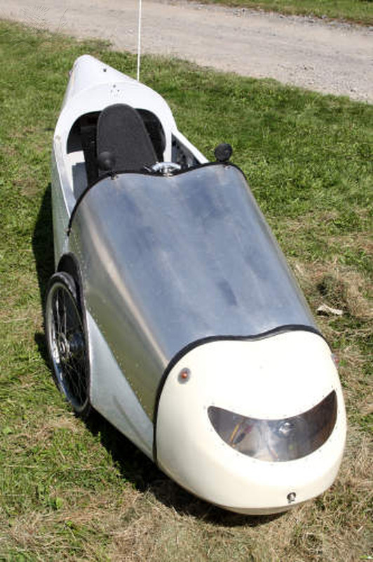 A velomobile, or bicycle car, is a human-powered vehicle, enclosed for protection from weather and collisions (from Britannica Image Quest).