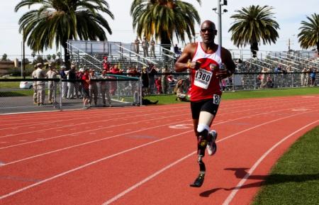Cpl John Shelton running on a track