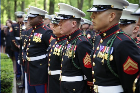 Marines in dress blues standing at attention