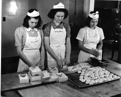Three Female Students Pack Biscuits, from Berea Digital