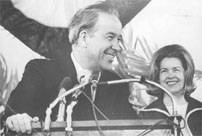Senator Henry M. Jackson speaking at an unidentified event with his wife, Helen Hardin, in the background, possibly in Washington, D.C., July 1974