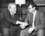 Senator Henry M. Jackson discussing a document with Bill Van Ness, Chief Counsel to the Energy and Natural Resources Committee, of which Jackson was chairman, Senate Office Building, Washington, D.C., February 16, 1977