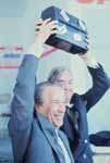 Senator Henry M. Jackson and Daniel Patrick Moynihan holding up a lunch box after Jackson's speech at an event for union workers during Jackson's campaign for the Democratic presidential nomination, Florida, 1975-1976