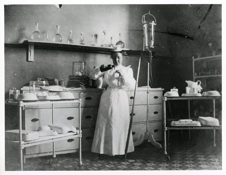 Historic Photo of Nurse Preparing a Clysis in Supply Room
