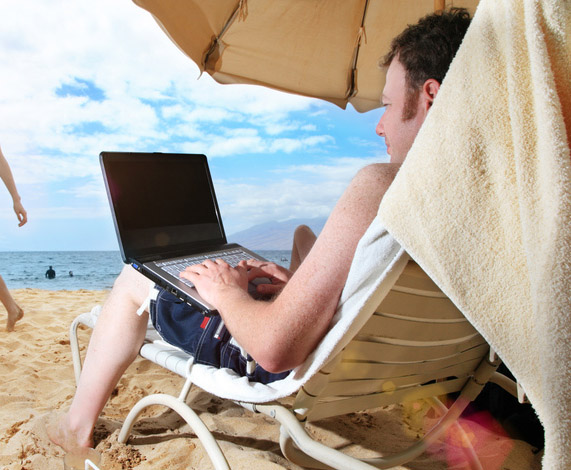 Reading eBook on the Beach