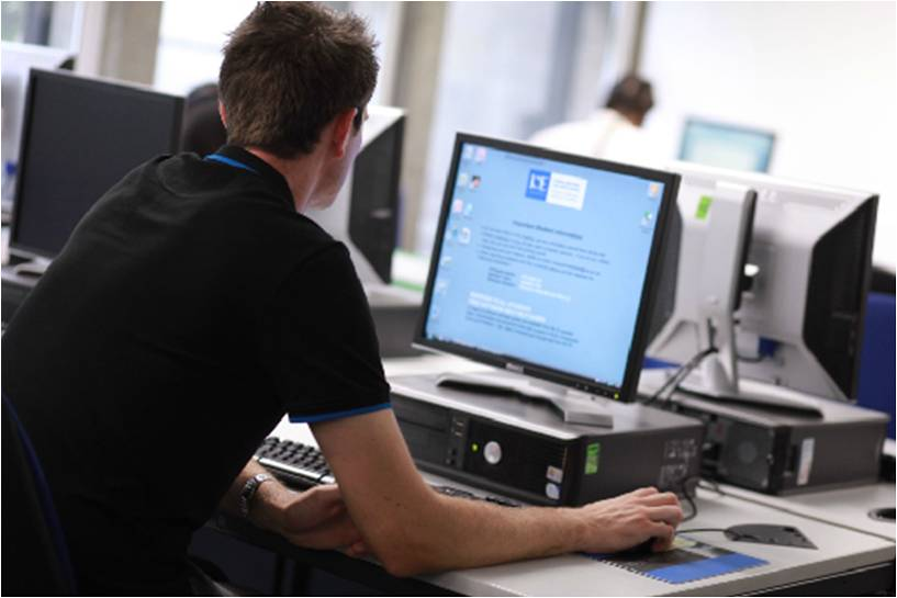 picture of person using computer