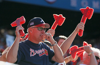 Atlanta Brave fans do the tomahawk chop