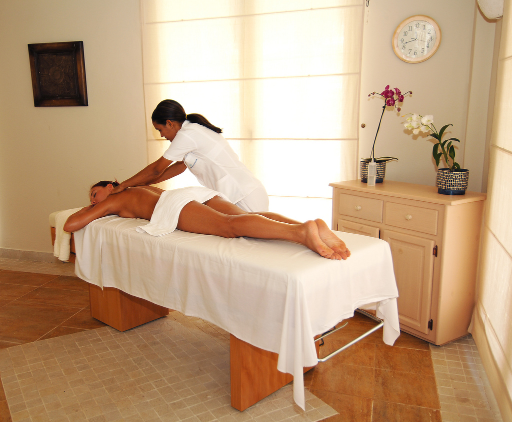 Image of a Massage therapist treating a client