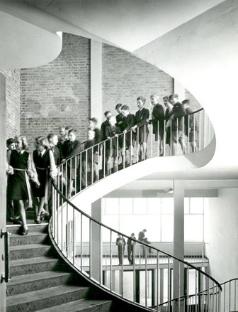 Photograph of students on staircase, interior of Copland Secondary Modern, circa 1953