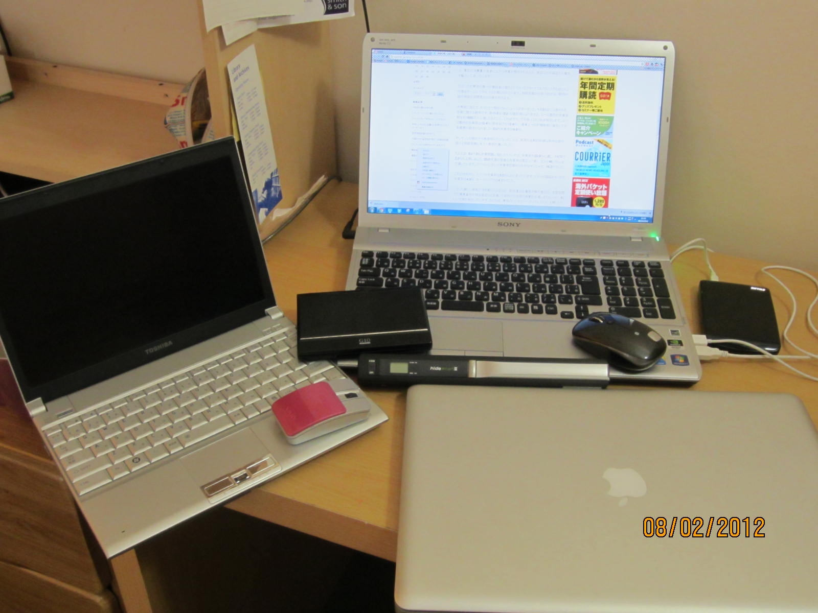 image of multiple laptops and external hard drives.