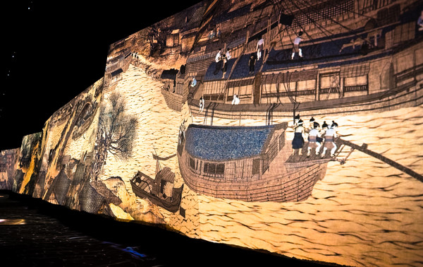 Artwork depicting a flowing river during the Qingming festival in China.