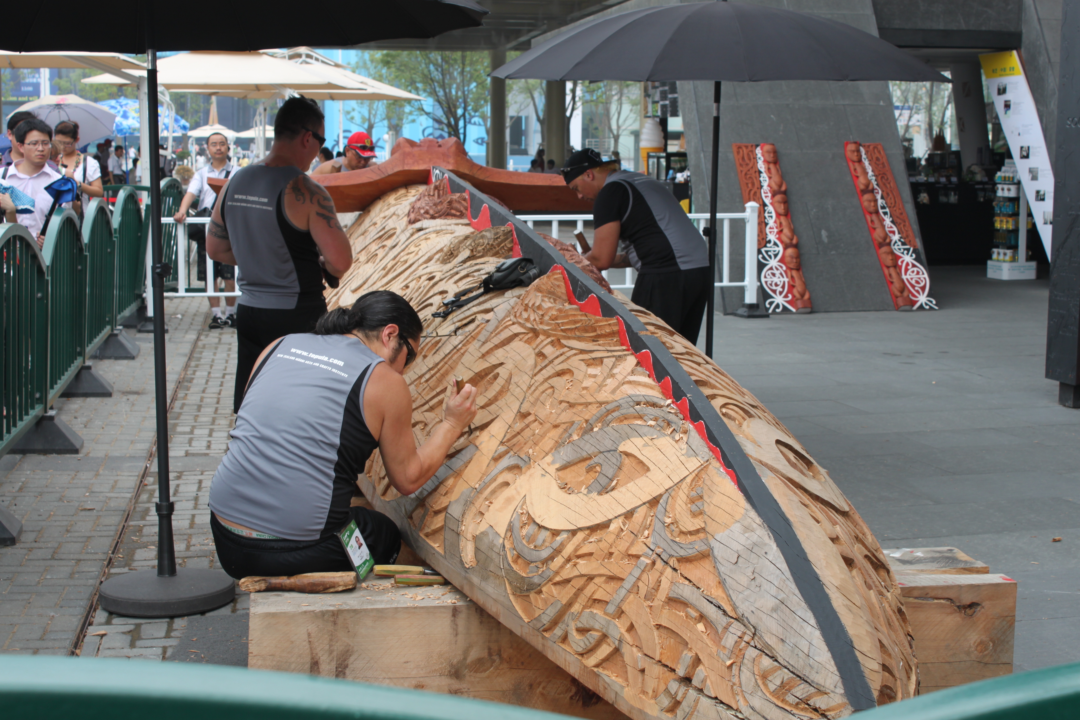 Wood carvers at work on a large sculpture.