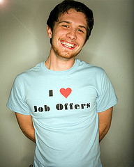 Smiling grad student with t-shirt reading I heart job offers