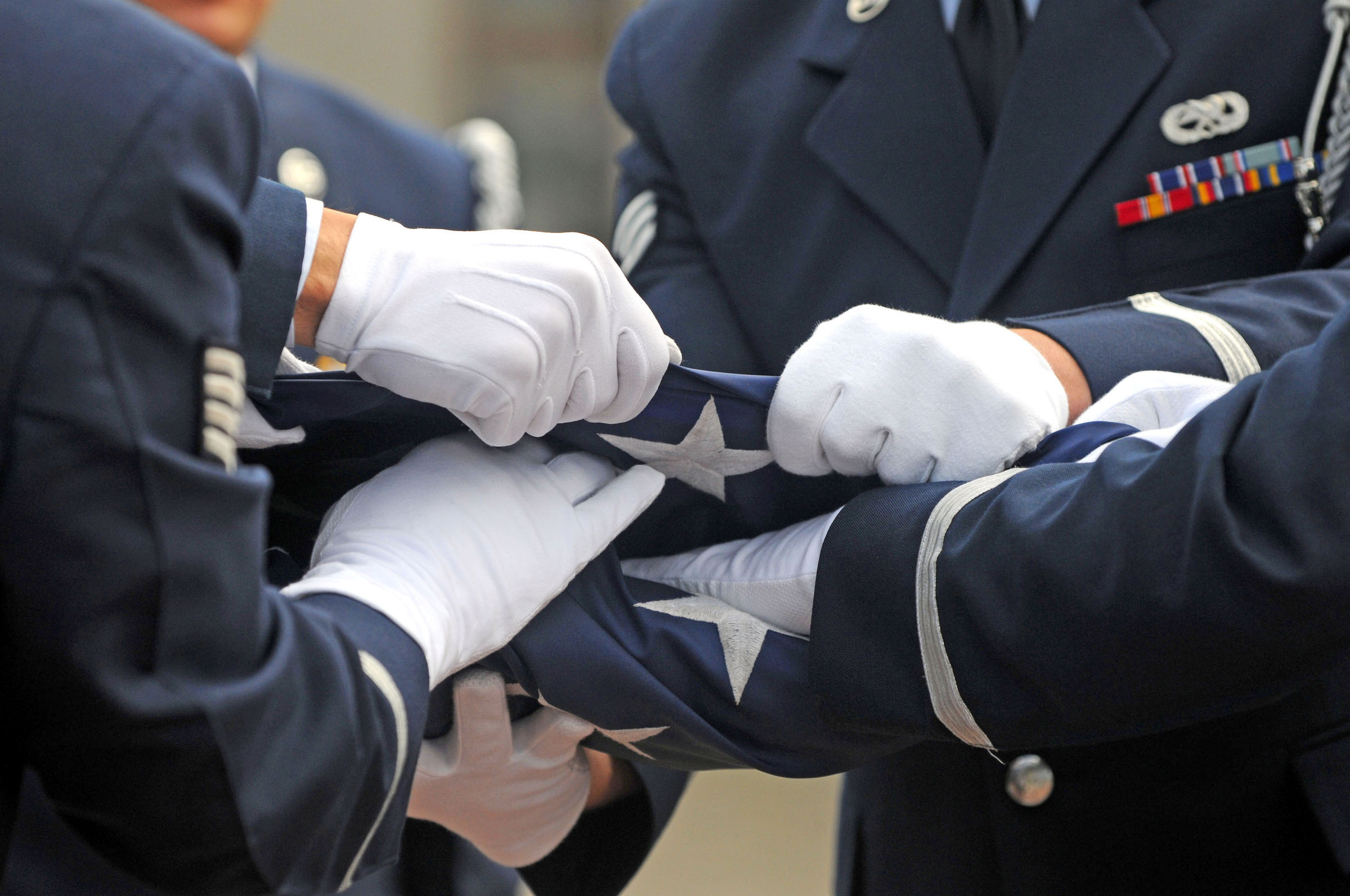 Honor guard folding American flag