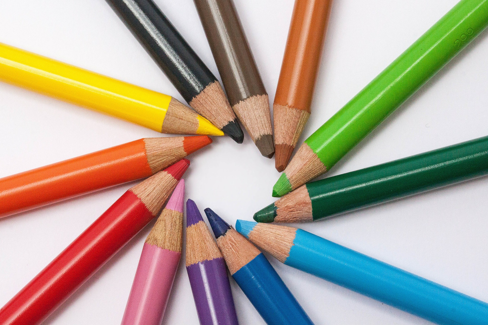 array of colored pencils on a table