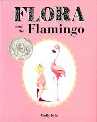 little girl in pink facing a flamingo