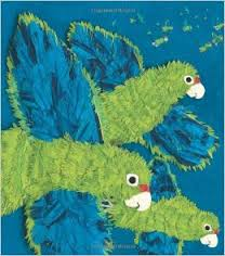 Bright blue and bright green parrots flying over Puerto Rico