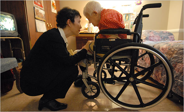 social worker talking to patient in wheelchair