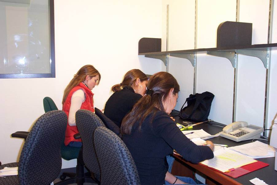 Photo of students working in a collaborative room
