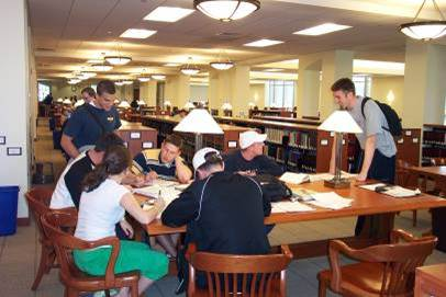 Photo of Students working at a library table