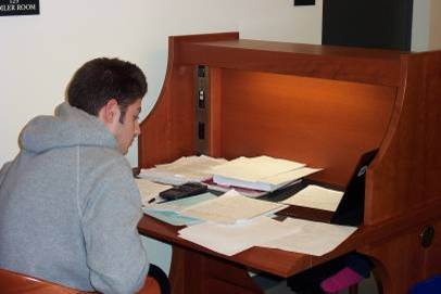 Photo of a student working at a private desk in the library