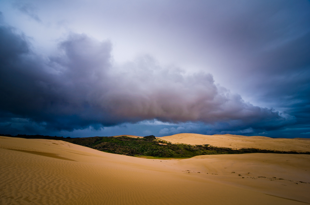 dramtic landscape with sand and dark clouds