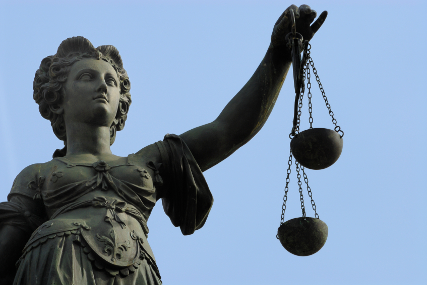stone statue of Lady Justice holding scales