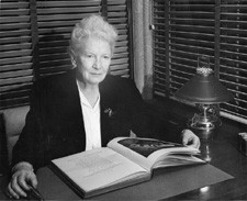 Image of Lois Borland at a desk