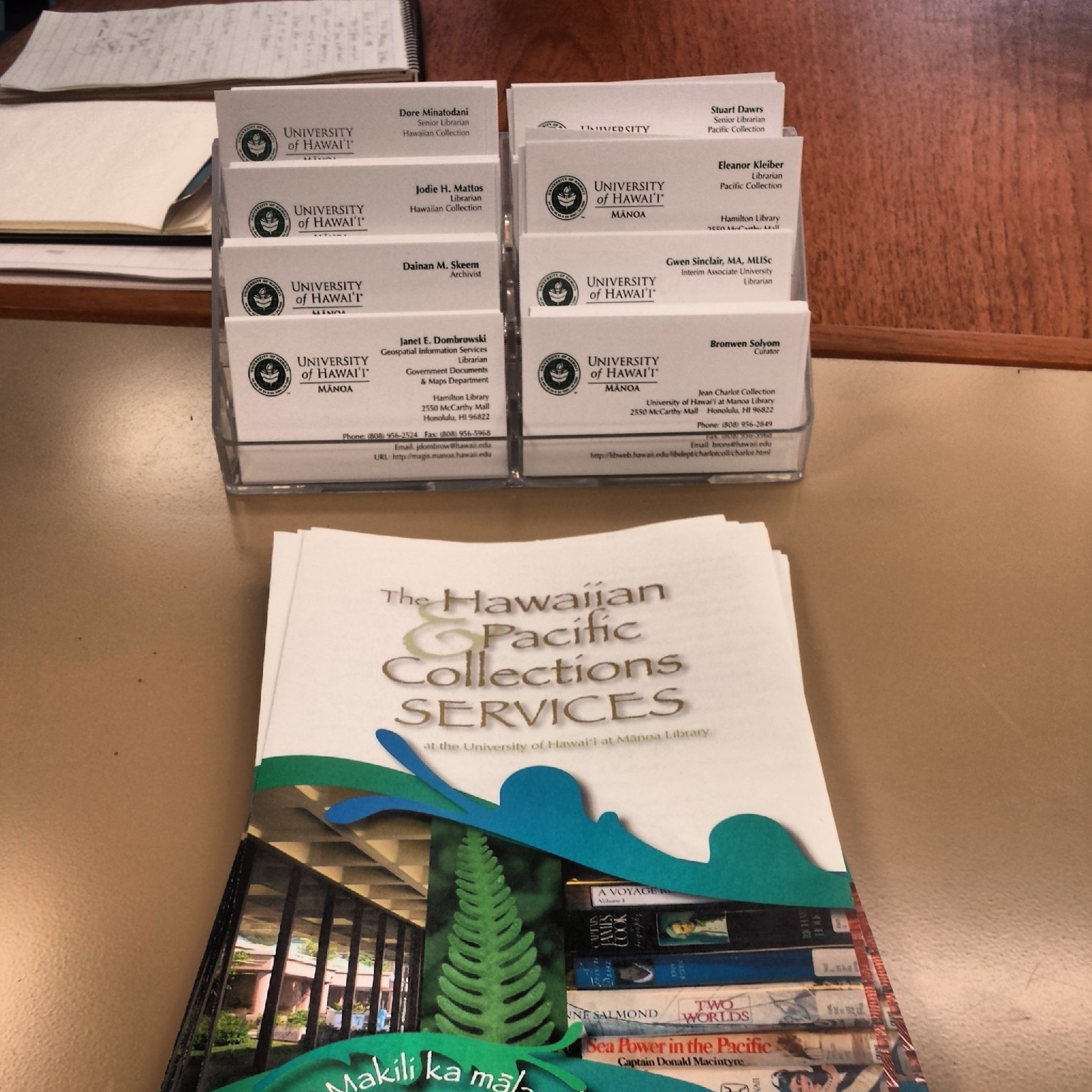 Pamphlets and business cards available at the reference desk